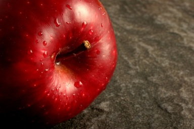Single Red Apple on Grey Stone