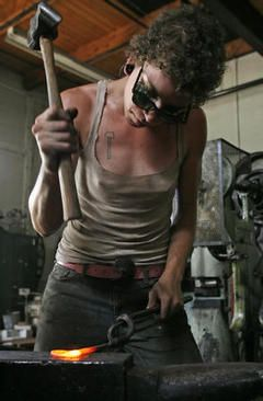 (7/20/08) New Orleans blacksmith artist Rachel David hammers part of a candle stick on the anvil at the Smartshop on a recent Sunday afternoon. David lives in the 9th Ward of New Orleans, onke of the areas hardest hit by Katrina. (John A. Lacko / Special to the Gazette)